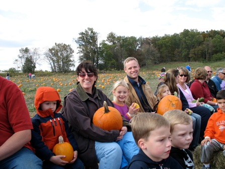 The Lahertys on the hayride, with their pumpkins.