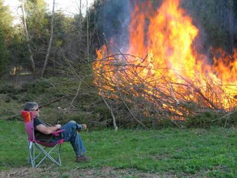 Bob enjoys the small inferno he has created.