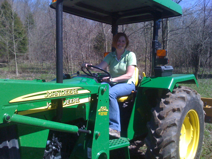 I got a lesson on driving the tractor -- sure wish it had an automatic transmission.